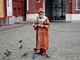 Tsar is feeding the pigeons